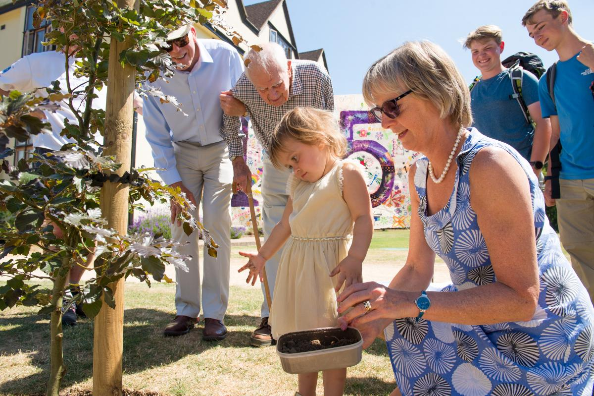 Old Bedalian Mike Sadler and three-year-old Liberty Camping planted a tree to commemorate Bedales' 125th anniversary